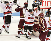 Kendall Coyne (NU - 77), Casey Pickett (NU - 14) - The Northeastern University Huskies defeated Boston College Eagles 4-3 to repeat as Beanpot champions on Tuesday, February 12, 2013, at Matthews Arena in Boston, Massachusetts.