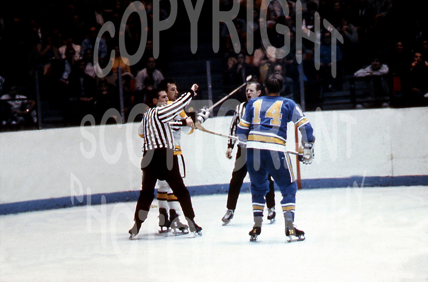 Wayne Maki,  St Louis Blues, and, Ted Green, Boston Bruins, hockey stick fight, in a pre season game in Ottawa Canada 1969 that left Ted Green paralized, Photo copyright, Image Communications/photo Ted Grant jr, National Hockey League