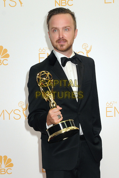 25 August 2014 - Los Angeles, California - Aaron Paul. 66th Annual Primetime Emmy Awards - Press Room held at Nokia Theatre LA Live. <br /> CAP/ADM/BGP<br /> &copy;BGP/ADM/Capital Pictures