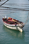 A dingy boat tied up to the US Brig Niagara