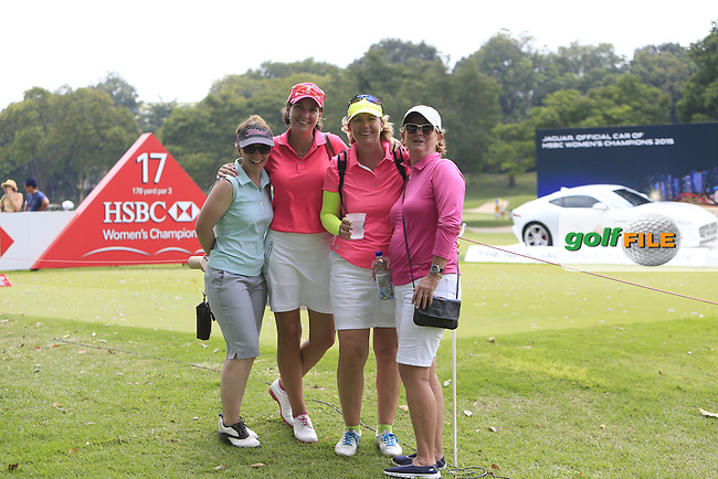 Three local Ladies and a friend from Belgium enjoying themselves during Round 2 of the HSBC Women's Champions at the Sentosa Golf Club, The Serapong Course in Singapore on Friday 6th March 2015.<br /> Picture:  Thos Caffrey / www.golffile.ie