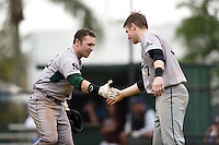 Slippery Rock Adam Urbania (20) is congratulated by James Divosevic (37) after hitting a home run during a game against the University of the Sciences Devils on March 6, 2015 at Jack Russell Field in Clearwater, Florida.  Slippery Rock defeated University of the Sciences 6-3.  (Mike Janes/Four Seam Images)