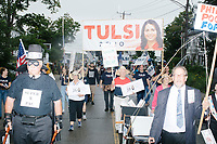 Supporters of Democratic presidential candidate and Hawaii representative (D-HI 2nd) Tulsi Gabbard march behind a group of campaign finance reformers during the Labor Day Parade in Milford, New Hampshire, on Mon., September 2, 2019. Candidates Bernie Sanders and Vermin Supreme were the only candidates who marched in the parade this year.