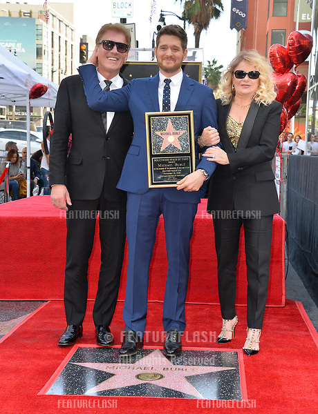 LOS ANGELES, CA. November 16, 2018: Michael Buble, Lewis Buble & Amber Santaga Buble at the Hollywood Walk of Fame Star Ceremony honoring singer Michael Bublé.<br /> Pictures: Paul Smith/Featureflash