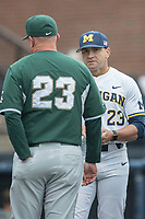 Michigan Wolverines head coach Erik Bakich (23) meets with Michigan State Spartans head coach Jake Boss Jr. (23) before the game on May 19, 2017 at Ray Fisher Stadium in Ann Arbor, Michigan. Michigan defeated Michigan State 11-6. (Andrew Woolley/Four Seam Images)