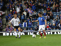 Ian Black watched by Ryan McGuffie in the Rangers v Queen of the South Quarter Final match in the Ramsdens Cup played at Ibrox Stadium, Glasgow on 18.9.12.