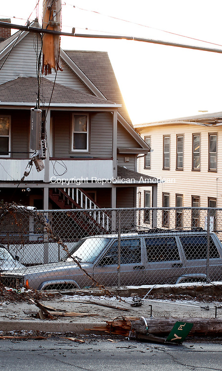 Waterbury, CT- 27 December 2013-122713CM04-  Pieces of a damaged utility pole lay on Wolcott Street after a car crash near the intersection of Wolcott and Howard Streets in Waterbury Friday afternoon .   Christopher Massa Republican-American