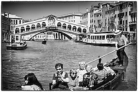 Japanese tourists in a gondola near the Rialto Bridge