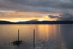 Idaho, North, Kootenai County, Coeur d'Alene. A mid autumn clearing storm reveals a colorful sunset over lake Coeur d'Alene.