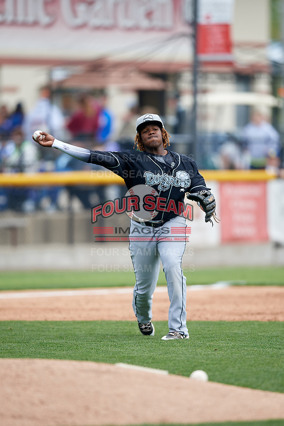 Lansing Lugnuts third baseman Vladimir Guerrero Jr. (27) throws to first base during a game against the Clinton LumberKings on May 9, 2017 at Ashford University Field in Clinton, Iowa.  Lansing defeated Clinton 11-6.  (Mike Janes/Four Seam Images)
