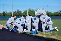 Members of the AZL Royals pray before an Arizona League game against the AZL White Sox at Camelback Ranch on June 19, 2019 in Glendale, Arizona. AZL White Sox defeated AZL Royals 4-2. (Zachary Lucy/Four Seam Images)