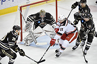 HERSHEY, PA - JANUARY 05: Hershey Bears goalie Vitek Vanecek (30) watches the puck as Grand Rapids Griffins left wing Turner Elson (15) takes a shot during the Grand Rapids Griffins vs. Hershey Bears AHL game at the Giant Center in Hershey, PA. (Photo by Randy Litzinger/Icon Sportswire)