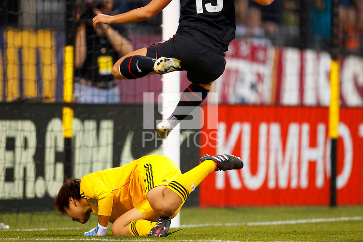 14 MAY 2011: USA Women's National Team forward Alex Morgan (13) leaps over Japan National team Ayumi Kaaihori during the International Friendly soccer match between Japan WNT vs USA WNT at Crew Stadium in Columbus, Ohio.