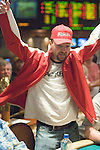 "Daniel Negreanu, who started the day short stacked, moves all in before the flop for $4,900. Mike ""The Grinder"" Mizrachi quickly calls from the button. As camera men and media crowd around the table, another player pushes all in for an additional $15,000. Mizrachi makes the call, and flips over pocket sevens. The other player shows pocket aces and Negreanu cringes as he turns up As-8s. The flop comes 2s-3s-3c. Negreanu pops out of his seat and screams for another spade. The turn comes Kd and the river is a 10h. Negreanu is eliminated from the tournament."