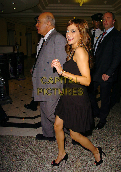 MOHAMED AL FAYED & BRITTANY MURPHY .Arrive to open the Harrods Summer Sale, .Knightsbridge, London, June 27th 2005..full length black Di Milo dress Christian Louboutin peep toe shoes.Ref: CAN.www.cap italpictures.com.sales@capitalpictures.com.©Can Nguyen/Capital Pictures