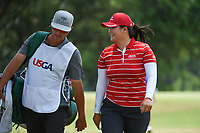 Angel Yin (USA) chats with her caddie on her way to the tee on 2 during round 4 of the 2019 US Women's Open, Charleston Country Club, Charleston, South Carolina,  USA. 6/2/2019.<br /> Picture: Golffile | Ken Murray<br /> <br /> All photo usage must carry mandatory copyright credit (© Golffile | Ken Murray)