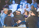 Final Hand: Hachem reacts as the cards are dealt and then gets a hug from his wife and supporters after winning the champioship.