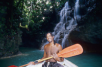 Guide taking boat tour into falls, Somerset Falls, Port Antonio, Jamaica, Caribbean