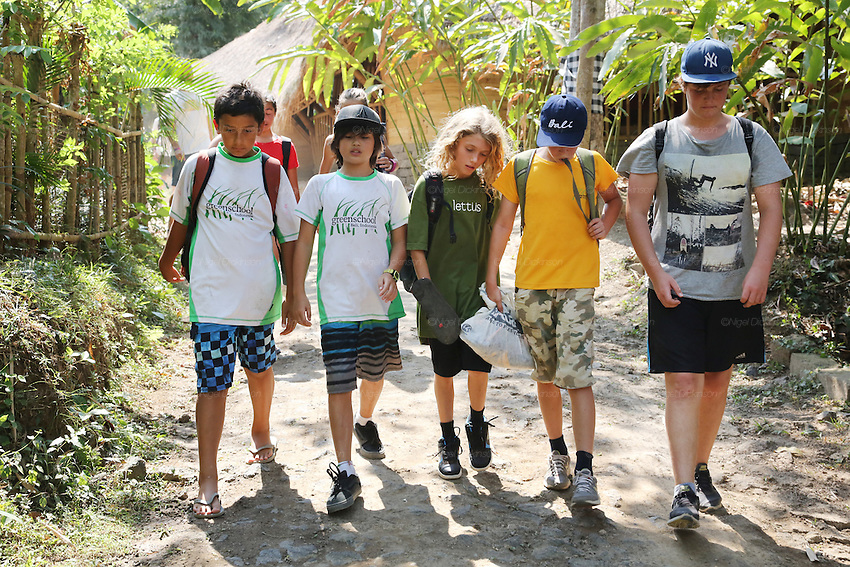 Secondary school students walking in the Green School Campus<br /><br />The Green School (Bali) is one of a kind in Indonesia. It is a private, kindergarten to secondary International school located along the Ayung River near Ubud, Bali, Indonesia. The school buildings are of ecologically-sustainable design made primarily of bamboo, also using local grass and mud walls. There are over 600 students coming from over 40 countries with a percentage of scholarships for local Indonesian students.<br /><br />The impressive three-domed &quot;Heart of School Building&quot; is 60 metres long and uses 2500 bamboo poles. The school also utilizes renewable building materials for some of its other needs, and almost everything, even the desks, chairs, some of the clothes and football goal posts are made of bamboo.<br /><br />The educational focus is on ecological sustainability. Subjects taught include English, mathematics and science, including ecology, the environment and sustainability, as well as the creative arts, global perspectives and environmental management. This educational establishment is unlike other international schools in Indonesia. <br /><br />Renewable energy sources, including solar power and hydroelectric vortex, provide over 50% of the energy needs of the school. The school has an organic permaculture system and prepares students to become stewards of the environment. <br /><br />The school was founded by John and Cynthia Hardy in 2008.