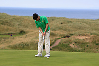 Dermot McElroy (IRL) on the 14th green during the Afternoon Singles between Ireland and Wales at the Home Internationals at Royal Portrush Golf Club on Thursday 13th August 2015.<br /> Picture:  Thos Caffrey / www.golffile.ie