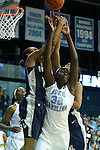 14 November 2012: North Carolina's Waltiea Rolle (32) challenges for a rebound against Georgetown's Andrea White (left) and Vanessa Moore (right). The University of North Carolina Tar Heels played the Georgetown University Hoyas at Carmichael Arena in Chapel Hill, North Carolina in an NCAA Division I Women's Basketball game, and a semifinal in the Preseason WNIT. UNC won the game 63-48.