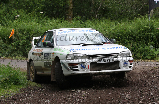 Alasdair Anderson - Richard Sutherland at junction 2 on Special Stage 6 Heathhall 2 on the Scottish Rally 2013, Round 3 of the BMSA British Rally Championship, Round 5 of the RAC MSA Scottish Rally Championship sponsored by ARR Craib Transport Limited and Round 7 of the Motoscope Northern Historic Rally Championship which was organised by the Royal Scottish Automobile Club and based at Dumfries on 29.6.13.