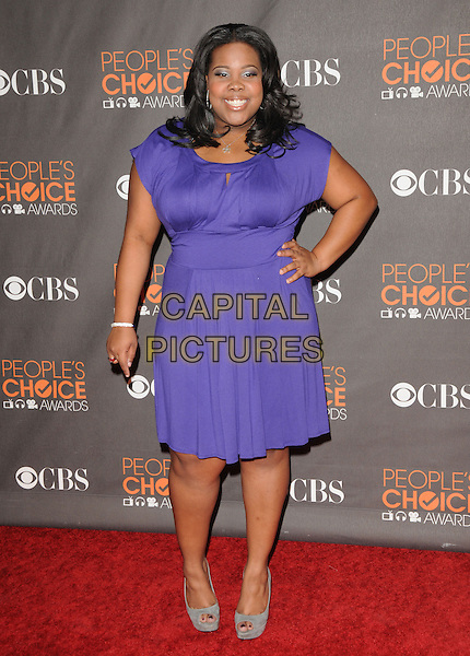 AMBER RILEY.Arrivals at the 2010 People's Choice Awards held at the Nokia Theater L.A. Live in Los Angeles, California, USA. .January 6th, 2010.full length purple dress hand on hip grey gray shoes .CAP/RKE/DVS.©DVS/RockinExposures/Capital Pictures.