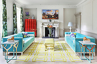 The sitting room retains the original Georgian architectural features and is furnished with an eclectic mix of furniture. The room is made sunnier with the use of yellow combined with turquoise. Geometric patterns provide additional impact and to give the room a more contemporary feel.