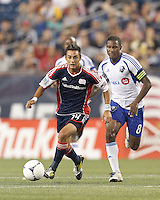 New England Revolution substitute forward Diego Fagundez (14) on the attack. In a Major League Soccer (MLS) match, Montreal Impact defeated the New England Revolution, 1-0, at Gillette Stadium on August 12, 2012.