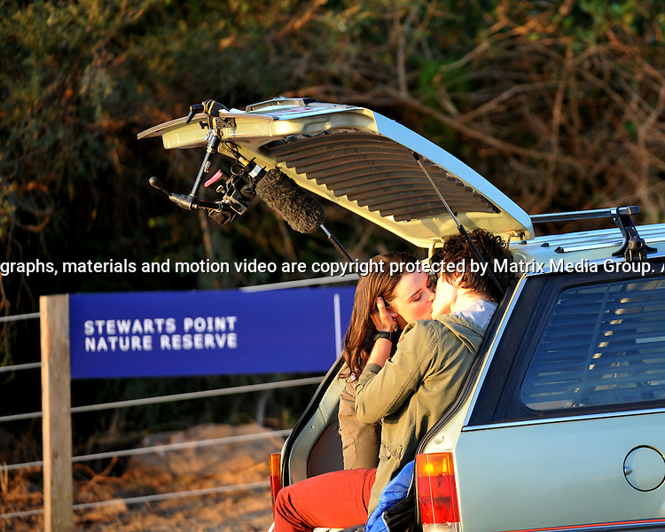 15th September,2014 SYDNEY,AUSTRALIA<br /> EXCLUSIVE <br /> Pictured,   Phillippa Northeast and Jackson Gallagher cast members of Home and Away doing a love scene in a station wagon at North Palm Beach (Summer Bay), Palm Beach, NSW. <br /> <br /> *No internet without clearance*.MUST CALL PRIOR TO USE +61 2 9211-1088. Matrix Media Group.Note: All editorial images subject to the following: For editorial use only. Additional clearance required for commercial, wireless, internet or promotional use.Images may not be altered or modified. Matrix Media Group makes no representations or warranties regarding names, trademarks or logos appearing in the images.