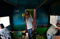 SANTIAGO DE CUBA, CUBA - APRIL 9: A man carries flowers during a trip from Santiago de Cuba to Bayamo on April 9, 2018.. in Cuba. Ferrocarriles de Cuba, is one of the oldest railroad around world, having opened its first route in 1837 with at least 17-mile long. Now the railway probably could cover more than 2,600 miles along the Island.  (Photo by Eliana Aponte/VIEWpress)