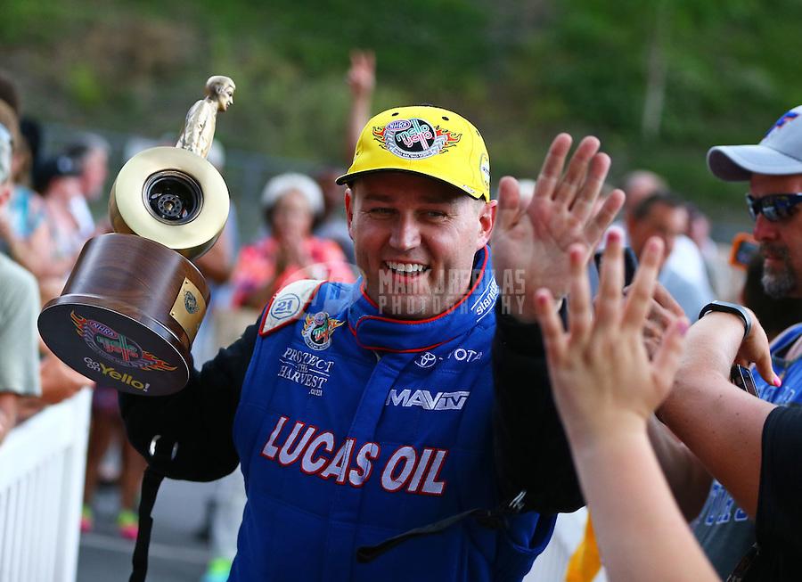 Jun 21, 2015; Bristol, TN, USA; NHRA top fuel driver Richie Crampton celebrates after winning the Thunder Valley Nationals at Bristol Dragway. Mandatory Credit: Mark J. Rebilas-USA TODAY Sports
