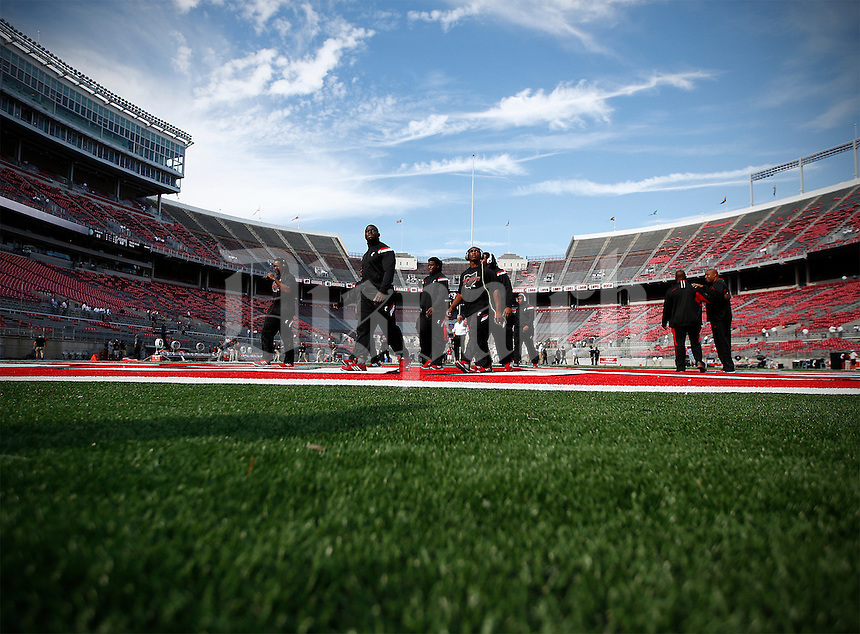 Cincinnati Bearcats walk on the field before the college football game between the Ohio State Buckeyes and the Cincinnati Bearcats at Ohio Stadium in Columbus, Saturday afternoon, September 27, 2014. (The Columbus Dispatch / Eamon Queeney)