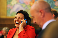 Pictured: Labour candidate for Gower constituency Tonia Antoniazzi speaks on her phone delighted at her win next to fellow candidate Geraint Davies, before the results are officially announced. Friday 09 June 2017<br />
