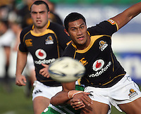 Wellington centre Robert Fruean passes in the tackle during the Air NZ Cup preseason match between Manawatu Turbos and Wellington Lions at FMG Stadium, Palmerston North, New Zealand on Friday, 17 July 2009. Photo: Dave Lintott / lintottphoto.co.nz