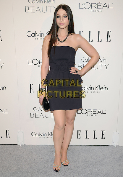 MICHELLE TRACHTENBERG.walks the carpet as Elle Honors Hollywood's Most Esteemed Women in the 17th Annual Women in Hollywood Tribute held at The Four Seasons Beverly Hills in Beverly Hills, California, USA, October 18th 2010..full length grey gray strapless black peplum dress clutch bag sandals silver hand on hip diamante .CAP/RKE/DVS.©DVS/RockinExposures/Capital Pictures.