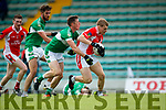 Cian Ó Murchu West Kerry in action against Jonathan Lyne and Jack O'Neill Legion in the Quarter Final of the Kerry Senior County Championship at Austin Stack Park on Sunday.