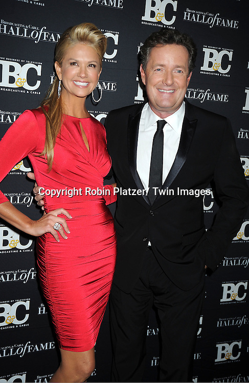 Nancy O'Dell and Piers Morgan attends the 2011 Broadcasting & Cable Hall of Fame Awards on October 26, 2011 at the Waldorf Astoria Hotel in New York City.