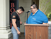 """Jesus Maldonado '00, Director of Upward Bound, and Giovanni Rubio.<br /> Upward Bound hosts their annual """"End of the Year"""" celebration with participants and their families on May 12, 2018 in the courtyard of Booth Hall. Jimmy Gomez, U.S. Representative for California's 34th congressional district, was the featured speaker at the event.<br /> Upward Bound was established at Occidental College in 1966 and has since served over 2000 first generation, low income students in the Los Angeles region.<br /> (Photo by Marc Campos, Occidental College Photographer)"""