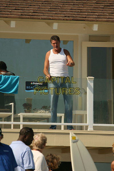 DAVID HASSELHOFF .Baywatch star David Hasselhoff enjoys the afternoon at the Polaroid House, Malibu, California, USA,.full length white vest top beach jeans balcony.CAP/ADM/RE.©Russ Elliot/AdMedia/Capital Pictures.