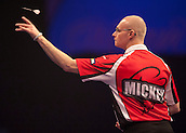 21.12.2014.  London, England.  William Hill World Darts Championship.  Mickey Mansell [NIR] in action during his game with Kim Huybrechts (18) [BEL]. Huybrechts won the match 3-0.