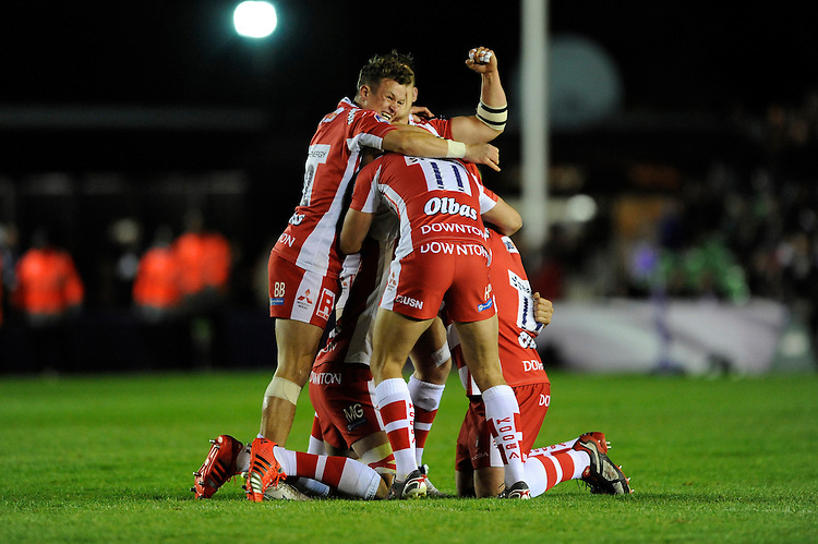 Billy Burns of Gloucester Rugby celebrates with team mates at the final whistle