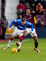26th January 2020, Tynecastle Park, Edinburgh, Scotland; Scottish Premier League football, Hearts of Midlothian versus Rangers;Ryan Kent of Rangers and Toby Sibbick of Hearts compete for  the ball