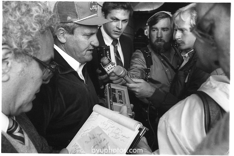 FTB 710 E 33<br /> <br /> Football BYU at the University of Utah (U of U). Coach LaVell Edwards with media personnel including KSL Radio. Ralph Zobell.<br /> <br /> November 17, 1984<br /> <br /> Photo by Mark Philbrick/BYU<br /> <br /> &copy; BYU PHOTO 2009<br /> All Rights Reserved<br /> photo@byu.edu  (801)422-7322
