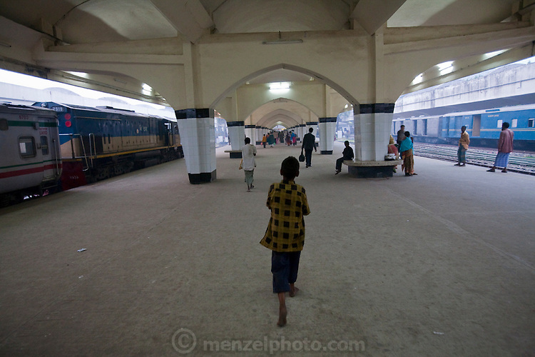 Alamin Hasan walks on the platform at the Kamalapur Railway Station in Dhaka, Bangladesh, where he works as a porter. (Featured in the book What I Eat: Around the World in 80 Diets.) MODEL RELEASED.