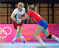 25 JUL 2012 - LONDON, GBR - Zoe van der Weel (GBR) (left) of Great Britain looks for a way past Vanessa Amoros Quilles (ESP) (right) of Spain during the women's London 2012 Olympic Games warm up handball match at The Copper Box in the Olympic Park, in Stratford, London, Great Britain (PHOTO (C) 2012 NIGEL FARROW)