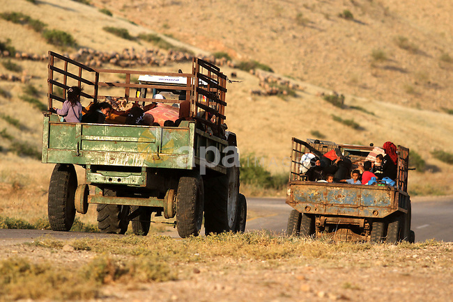 Bedouins load belongings into the back of a pick-up truck as he and his family leave their home in the West Bank village of Wadi al-Maleh, near the border with Jordan April 29, 2013. Israeli soldiers on Monday evicted several hundred Bedouins from the village in the occupied West Bank after the army declared the area a live-fire training zone. The residents of Wadi al-Maleh, a village mostly inhabited by shepherds in the arid area, had almost all left their homes by an evening curfew and retreated to neighbouring villages, a local leader told Reuters. Photo by Issam Rimawi