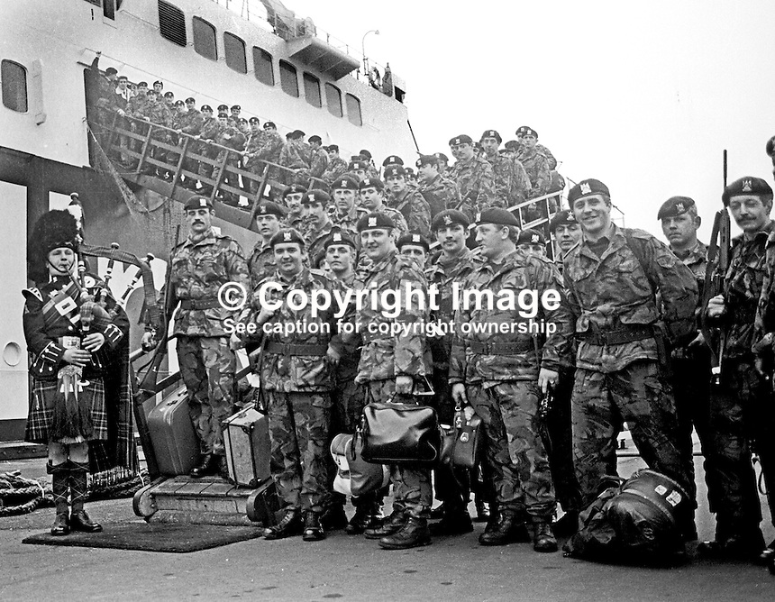 Piper Major Bruce Campbell pipes his comrades in the Royal Scots Dragoon Guards aboard the Larne-Stranraer passenger ferry following a tour of duty in N Ireland. Piper Campbell was one of the pipers who made the bit record, Amazing Grace. 30th October 1973. 197310300676b<br /> <br /> Copyright Image from Victor Patterson, 54 Dorchester Park, Belfast, UK, BT9 6RJ<br /> <br /> Tel: +44 28 9066 1296<br /> Mob: +44 7802 353836<br /> Voicemail +44 20 8816 7153<br /> Email: victorpatterson@me.com<br /> <br /> <br /> IMPORTANT: If you wish to use this image or any other of my images please go to www.victorpatterson.com and click on the Terms &amp; Conditions. Then contact me by email or phone with the reference number(s) of the image(s) concerned.