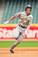 Brooks Pinckard #16 of the Baylor Bears hustles towards third base against the Houston Cougars at Minute Maid Park on March 4, 2011 in Houston, Texas.  Photo by Brian Westerholt / Four Seam Images