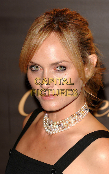 AMBER VALETTA.Cartier celebrates 25 years in Beverly Hills, in honour of projest A.L.S. held at the Rodeo Drive Boutique, Beverly Hills, Los Angeles, California, USA,.May 9th 2005..portrait headshot pearls necklace beads choker.Ref: MOO.www.capitalpictures.com.sales@capitalpictures.com.©Capital Pictures.